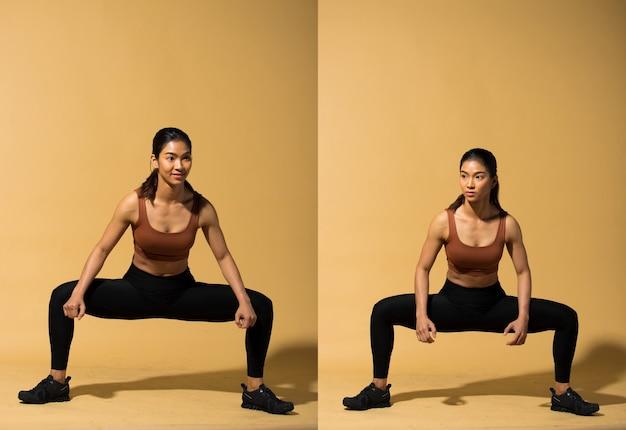 Asian slim fitness donna esercizio warm up stretch braccia gambe, studio illuminazione giallo beige senape sfondo ombra copia spazio, concetto woman can do atleta sport 6 confezioni
