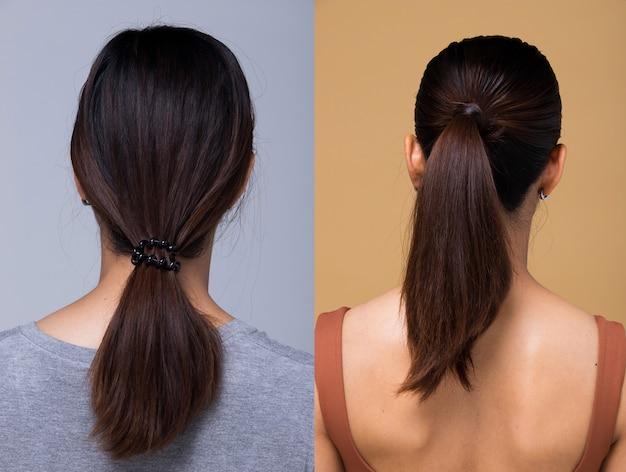 Donna asiatica prima di applicare il trucco stile di capelli. nessun ritocco, faccia fresca vista dal retro, dettaglio dei capelli avvolti. sfondo bianco di illuminazione dello studio,