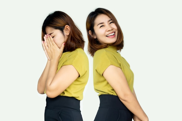 Donna asiatica che ha problemi con due personalità o bipolare con una faccia diversa lunatica triste e felice