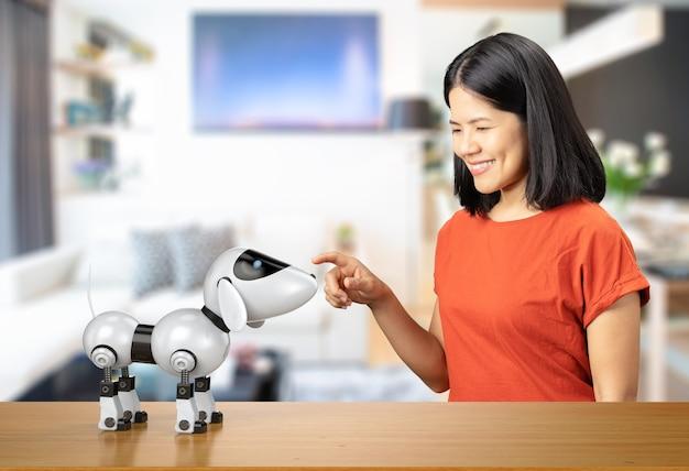 Donna asiatica con robot cane su sfondo bianco