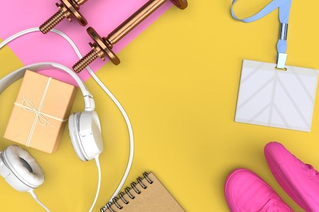 Kit da atleta con scarpe da ginnastica rosa, manubri, regalo, cuffie e su sfondo giallo