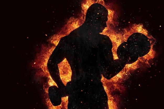 Uomo muscoloso atletico che allena i bicipiti in palestra con effetto fuoco