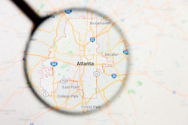 Concetto illustrativo di visualizzazione della città di atlanta sullo schermo tramite la lente d'ingrandimento
