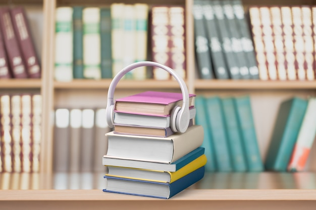 Concetto di audiolibro, libri e cuffie sullo sfondo