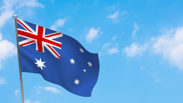 Bandiera dell'australia in pole. cielo blu. bandiera nazionale dell'australia