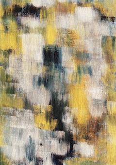 Le foglie secche gialle terrose di stagione autunnale colorano il fondo astratto di struttura della pittura acrilica