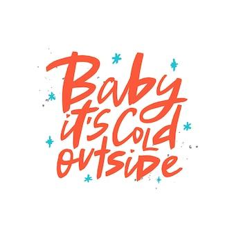 Baby fa freddo fuori dalla scritta a pennello tipografia invernale scritta a mano