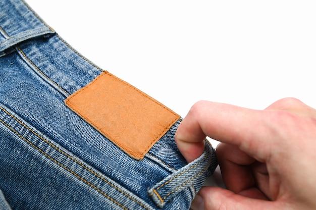 Etichetta posteriore sui jeans, da vicino. foto di alta qualità