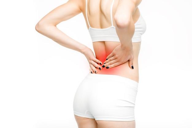 Mal di schiena, donna con mal di schiena su bianco