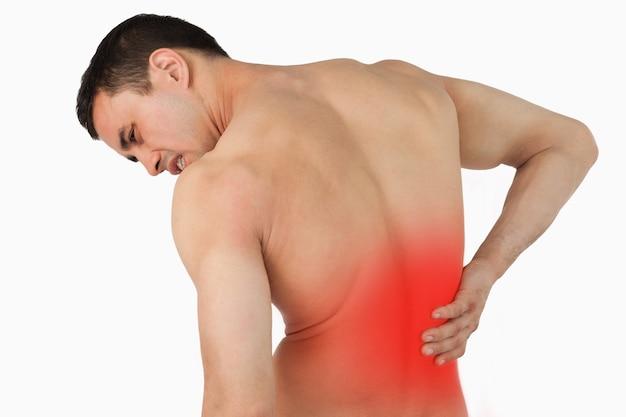 Vista posteriore del maschio che soffre di mal di schiena