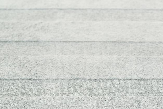 Sfondo di asciugamani da bagno con motivo a strisce. sfondo di tessuto strutturato