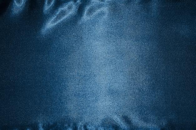 Sfondo di tessuto blu, trama di sfondo tessile blu.