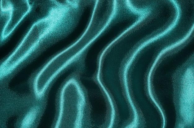 Sfondo di tessuto blu, texture di carta da parati agitando il tessuto nero.