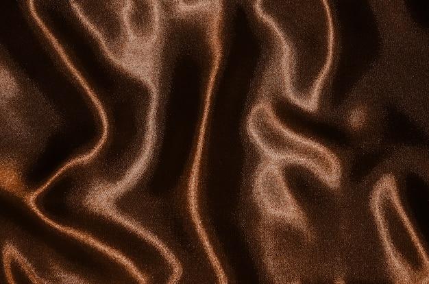 Sfondo di tessuto marrone, texture di carta da parati agitando il nero tessile.