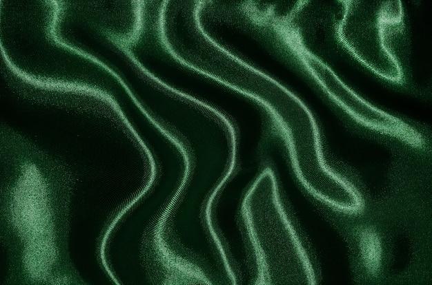Sfondo di tessuto verde, texture di carta da parati agitando tessile verde.