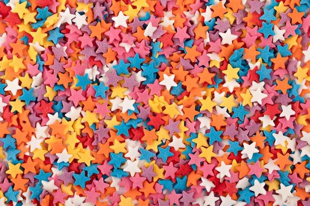 Sfondo di stelle di pasticceria colorate