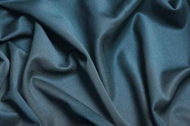Tessuto di fondo. tessuto tessile blu scuro con texture