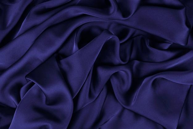 Tessuto di fondo. tessuto scuro con trama e motivo a drappeggi sullo sfondo