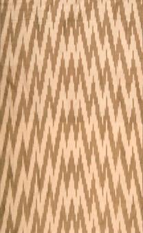 Sfondo del tessuto e del tessuto con ornamenti orientali e motivo marrone