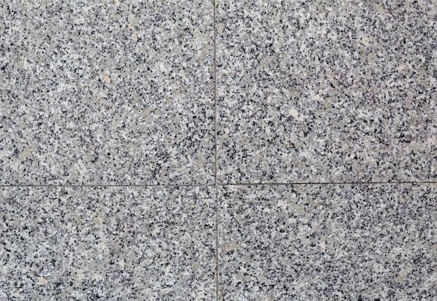 Sfondo di piastrelle di marmo grigio, piano generale, muro di pietra