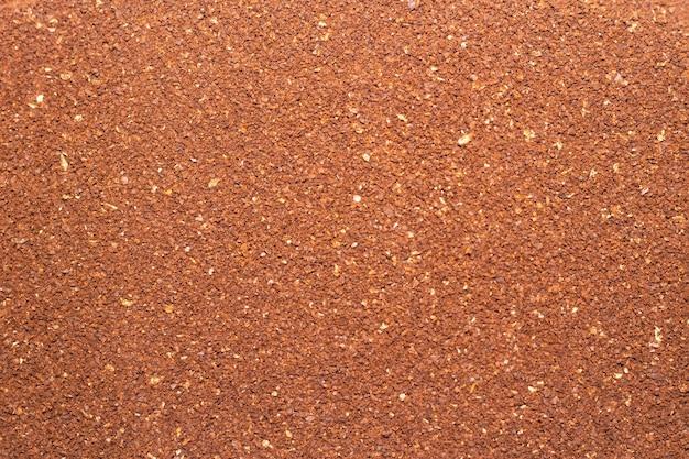 Fondo del primo piano del caffè insolubile macinato texture del caffè macinato