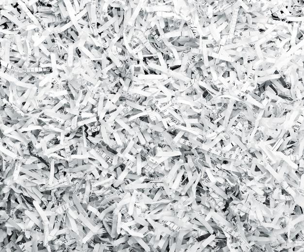 Sfondo di un mucchio di fogli bianchi sminuzzati