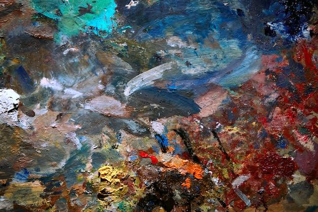 Immagine di sfondo della fine luminosa della tavolozza della pittura ad olio su