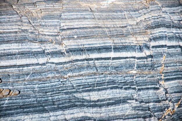 Lo sfondo è una trama di un piatto naturale fatto di vene colorate bianche di marmo di karar