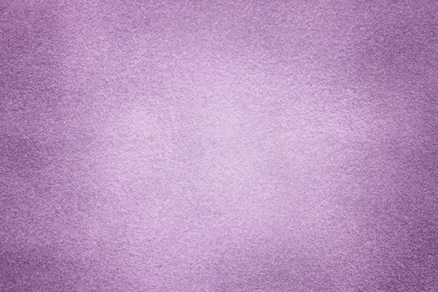 Sfondo di tessuto in pelle scamosciata viola chiaro primo piano velluto opaco trama di tessuto lilla nabuk