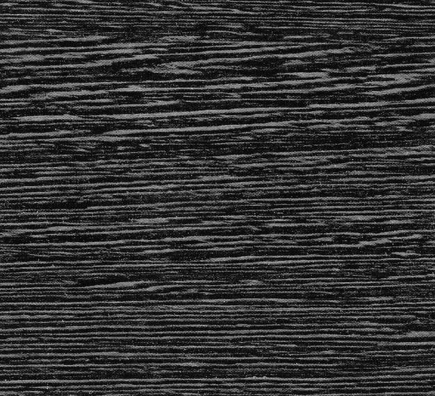 Sfondo di legno nero naturale, struttura superficiale irregolare