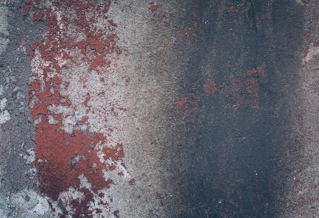 Sullo sfondo di un vecchio muro colorato vernice scrostata. modello di materiale grunge rustico.