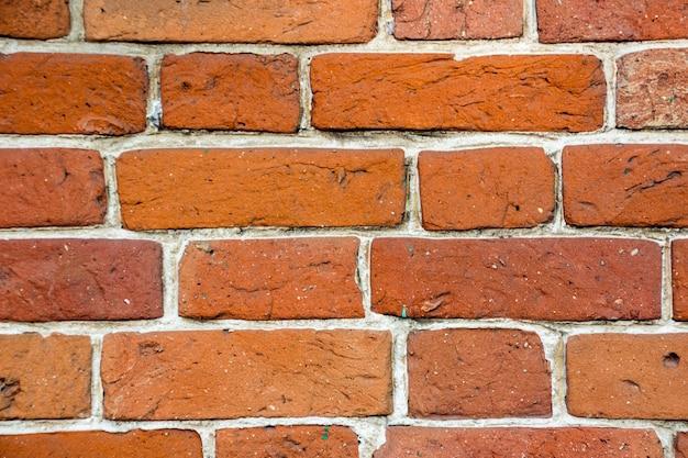 Sfondo del vecchio muro di mattoni d'epoca. vecchio fondo di struttura del muro di mattoni rossi.