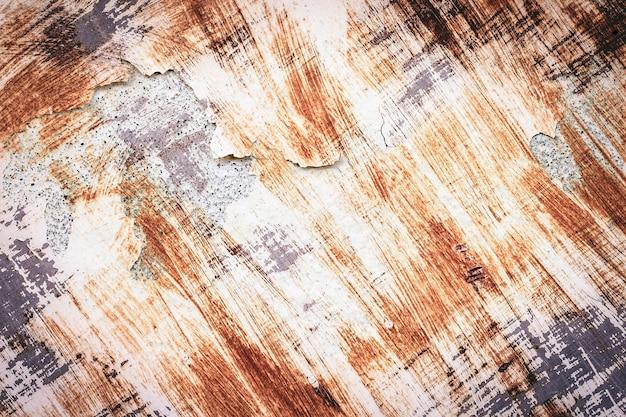 Sfondo di vernice scrostata e vecchio metallo arrugginito