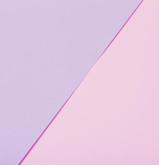Sfondo di fogli di carta pastello rosa e viola