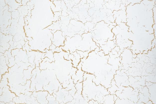 Fondo della struttura dello stucco con l'effetto dell'argilla secca. sfondo artistico fatto a mano