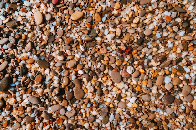 Trama di sfondo della spiaggia di ciottoli