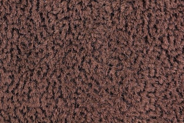 Fondo e struttura del primo piano del tessuto colorato marrone brown