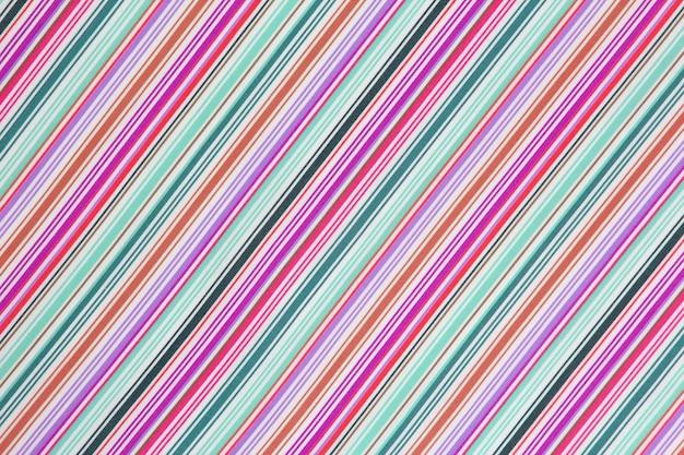 La trama di sfondo del tessuto in una striscia diagonale colorata