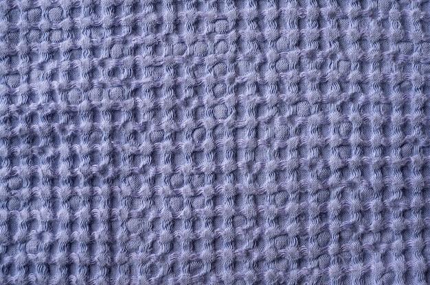 Texture di sfondo sotto forma di una maglia di asciugamani di lino e cotone vicino il fuoco selettivo