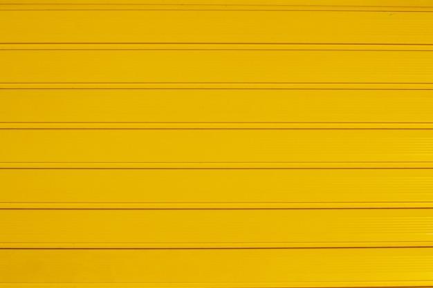 Texture di sfondo di pannelli di cancello giallo orizzontale