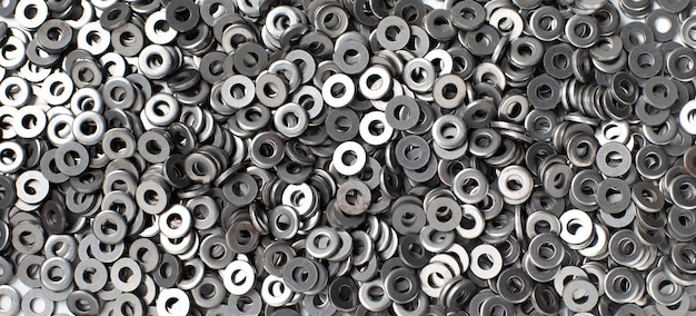 Trama di sfondo della rondella di dado in metallo. rondella dado in acciaio.