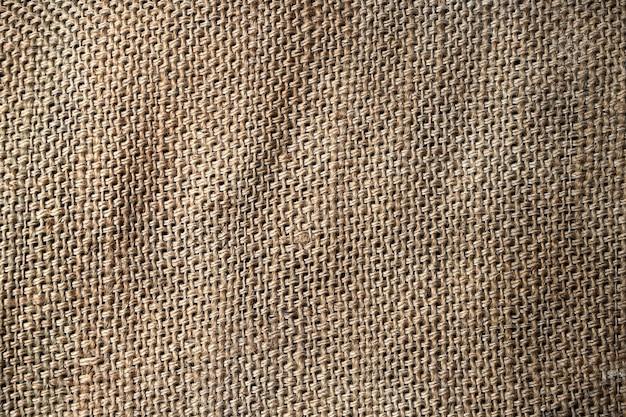 Sfondo e trama di tela di sacco marrone naturale con cucitura a punti
