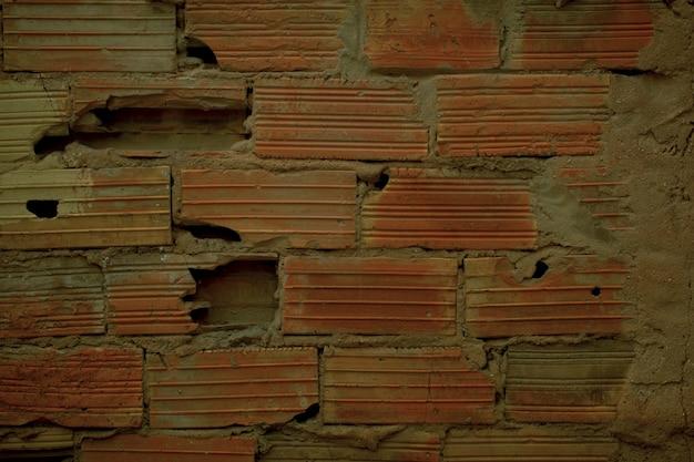 Texture di sfondo di vecchi mattoni rotti grunge in un muro danneggiato