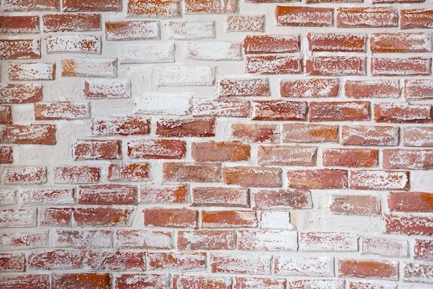 Fondo e struttura di un muro di mattoni dipinto