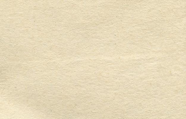 Trama di sfondo carta tonalità di colore giallo