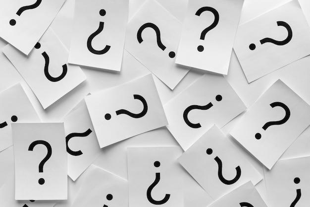 Trama di sfondo di punti interrogativi stampati