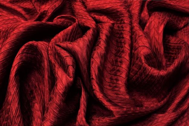 Trama di sfondo di tessuto di seta color mattone. modello vista dall'alto.