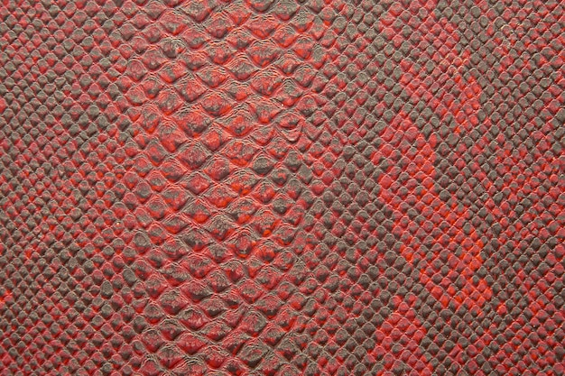 Texture di sfondo della pelle di serpente rosso brillante