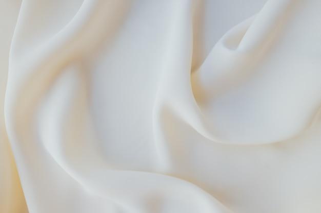 Trama di sfondo di tessuto bianco e beige.