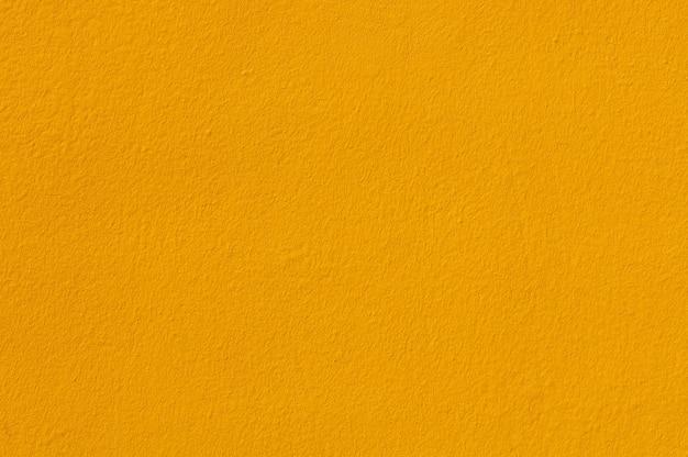 Sfondo e texture con vernice di colore giallo su intonaco murale.